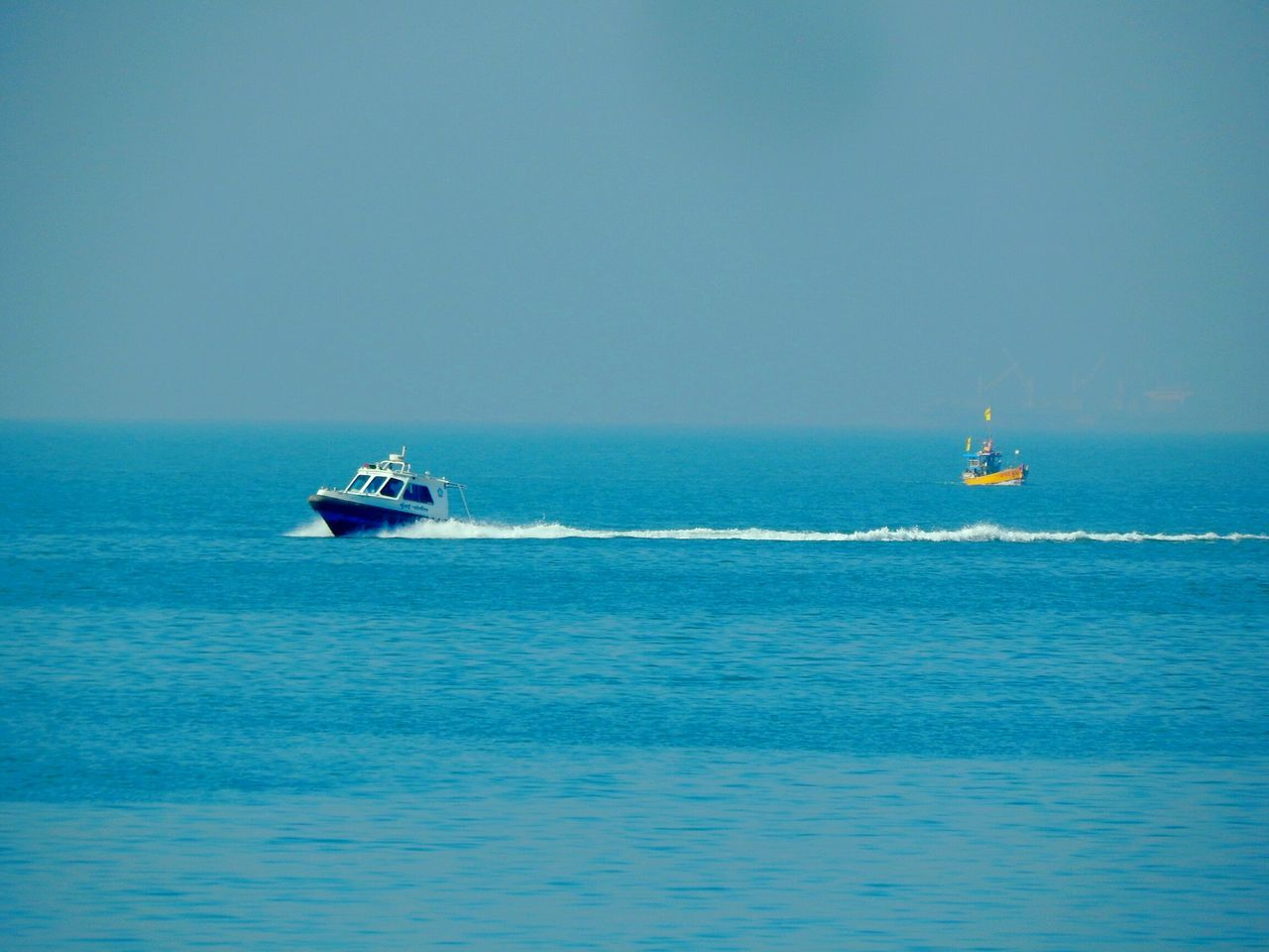 sea, nautical vessel, transportation, water, nature, mode of transport, blue, waterfront, horizon over water, outdoors, day, beauty in nature, sailing, scenics, jet boat, clear sky, no people, sky