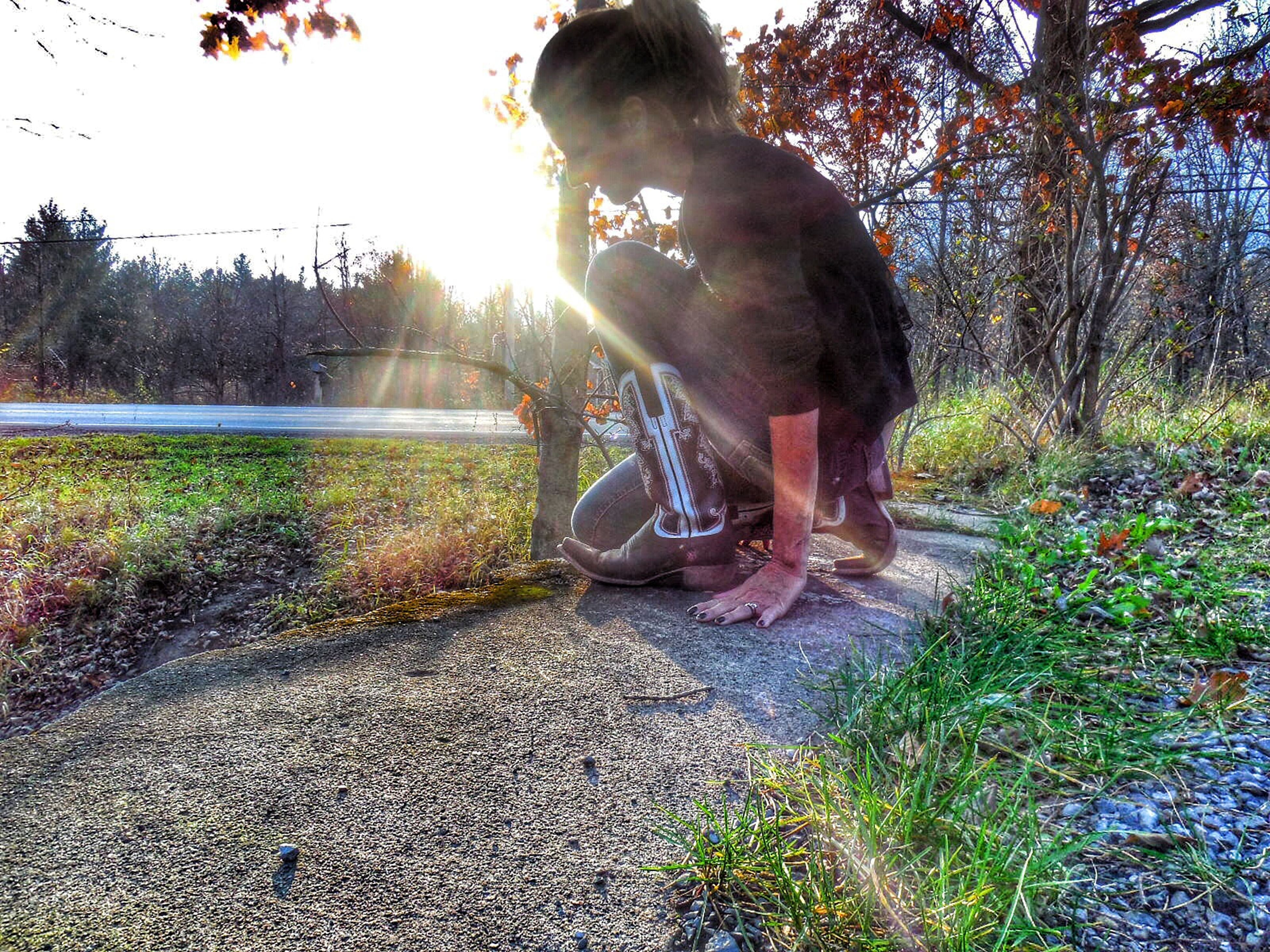 lifestyles, leisure activity, water, sunlight, sunbeam, tree, plant, person, sitting, casual clothing, young adult, nature, day, grass, sun, outdoors, young women, lens flare