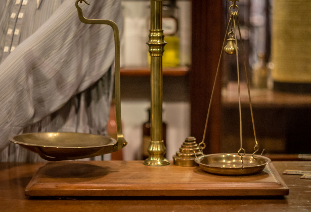 Absence Antique Close-up Elégance Empty Focus On Foreground Hanging Home Interior Illuminated In A Row Indoors  Justice Lady Justice Lighting Equipment Luxury Metal Scales No People Old-fashioned Scales Selective Focus Still Life Table Vase Weight Wood - Material