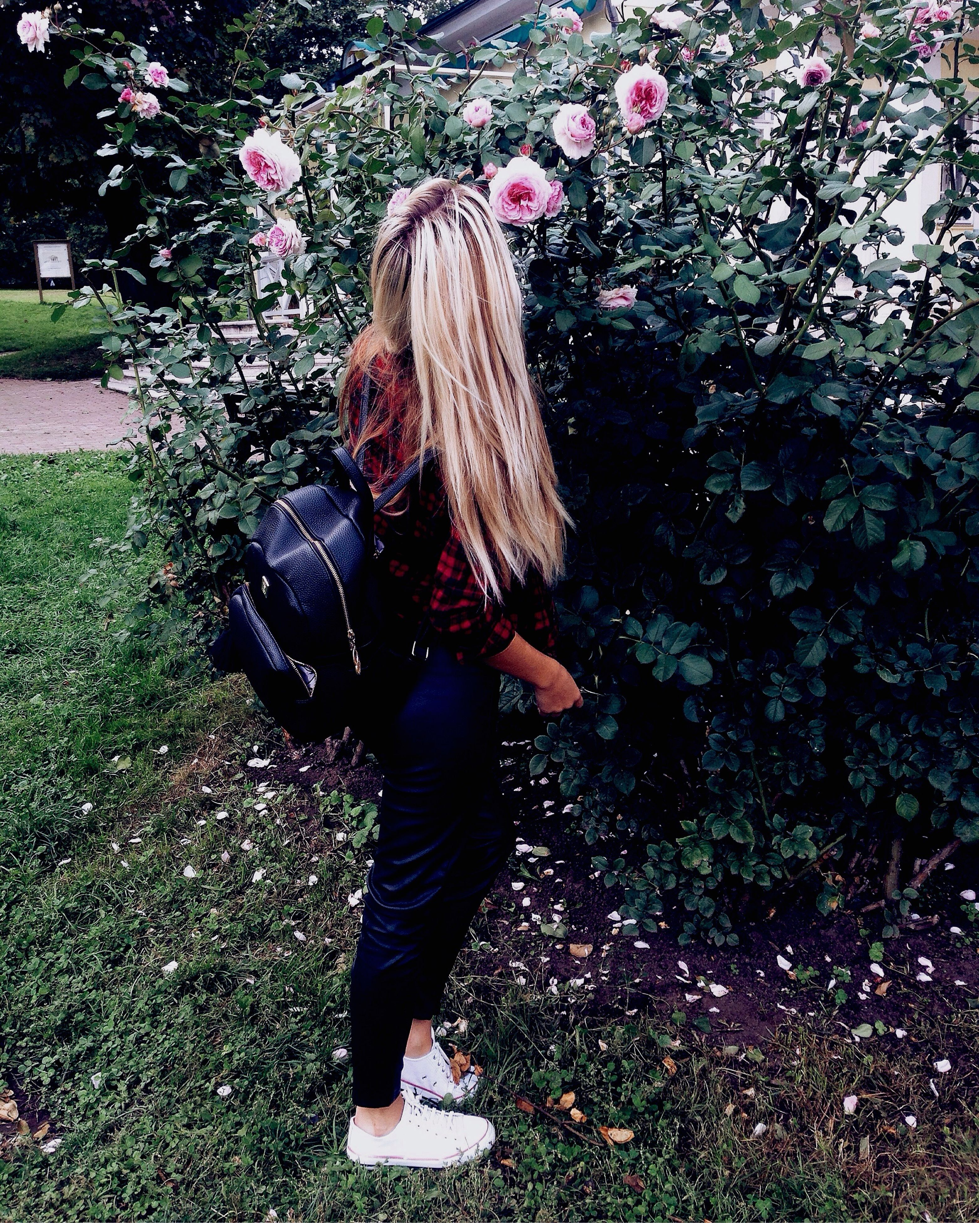 long hair, lifestyles, leisure activity, full length, casual clothing, tree, growth, leaf, plant, green color, day, nature, innocence, footpath, outdoors, flower, beauty in nature, tranquility