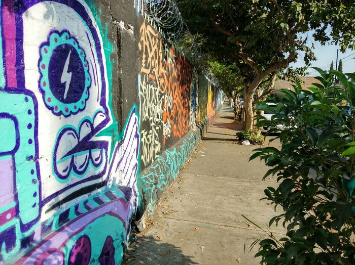 Graffiti Art And Craft Creativity Street Art Day Outdoors No People Multi Colored Close-up Camino Patch Wall