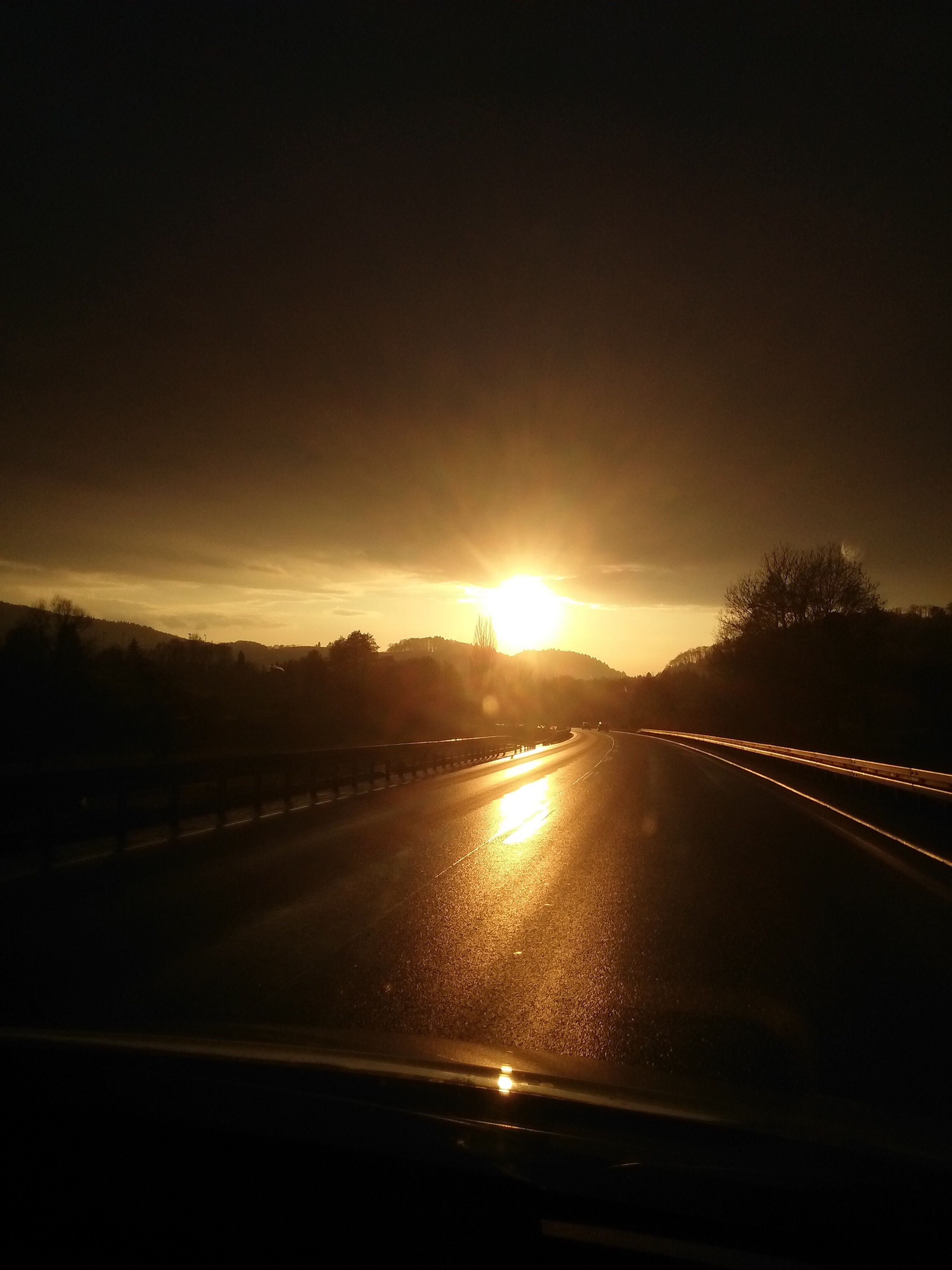 sunset, road, sun, scenics, tranquil scene, orange color, idyllic, water, beauty in nature, tranquility, sky, nature, remote, outdoors, majestic, country road, cloud - sky, no people, outline, non-urban scene