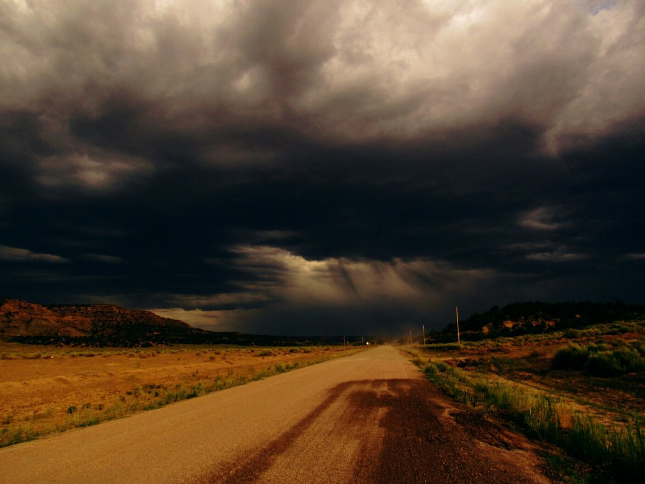 Dirtroad,rain,clouds