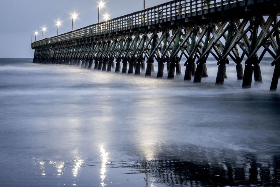 Evening at the pier In A Row Water Winter Architecture Outdoors Cold Temperature Built Structure Sea No People Night Sky Illuminated Nature Long Exposure Evening Beach Sand Pier Ocean