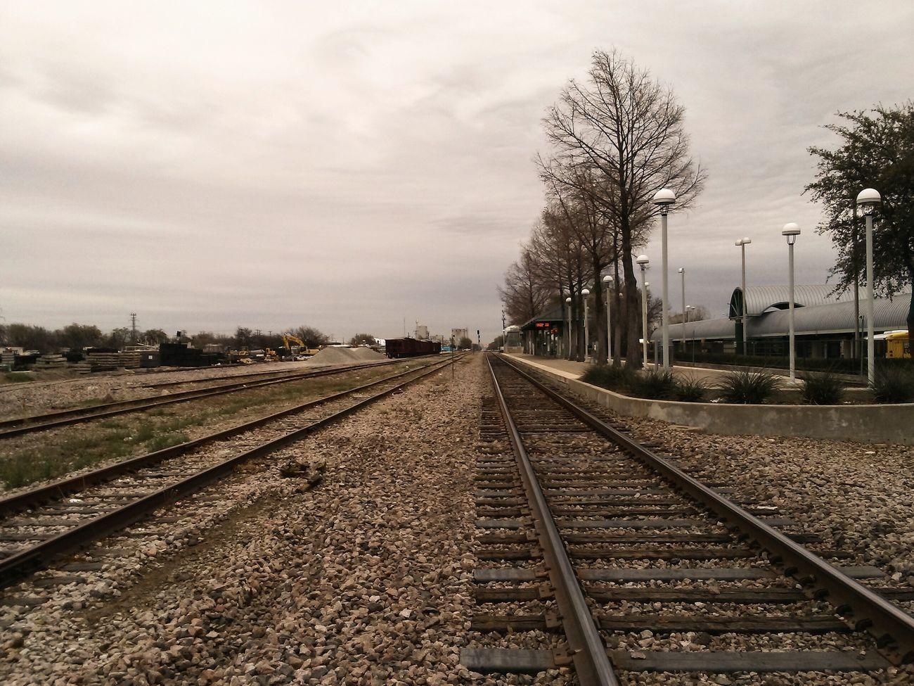 Railroad to adventure. . . . . . . . . . Tree Outdoors City Sky Clouds Railroad Track Travel Train Edit Amazing Streetphotography Dallas Dallas Tx Irving Simple Simple Beauty Startup Peace Tranquility Amazing View Dtx  Dtxstreet Vision Gallery Hustle