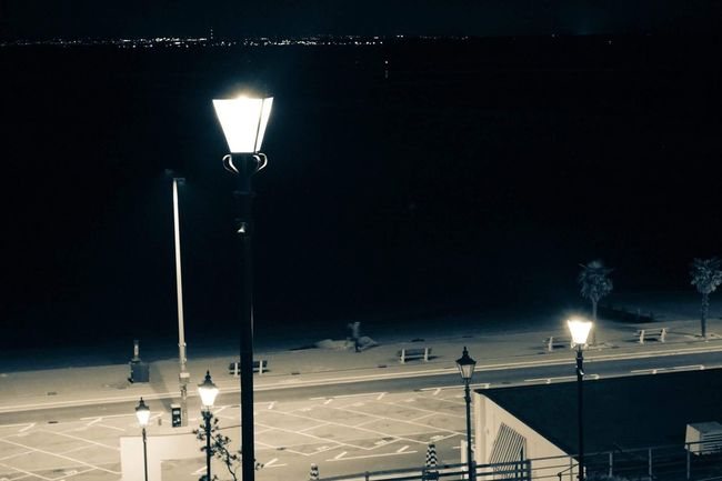 Nighttime at Southend Beach Night Nightphotography Southend On Sea Beach Split Tone Filter Lampost Street Light Street Outdoors Illuminated Electric Light Dark Road Edited Filtered Image