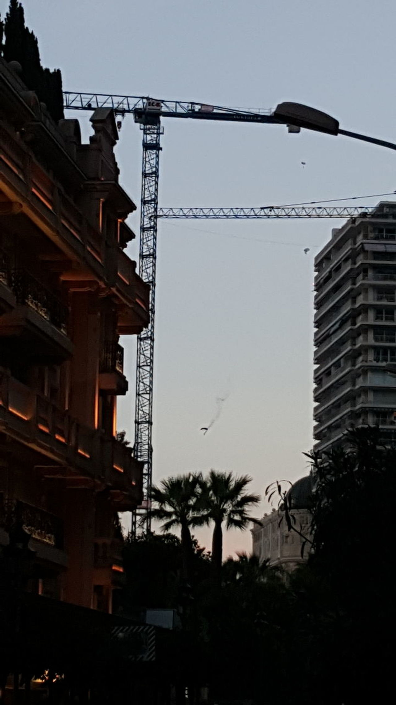 Parachute Parachuting Parachute Jump Fumigène Monaco Business Finance And Industry Architecture Built Structure Silhouette Construction Site Outdoors City Building Exterior No People Golf Club Sky Tree Day Metal Industry