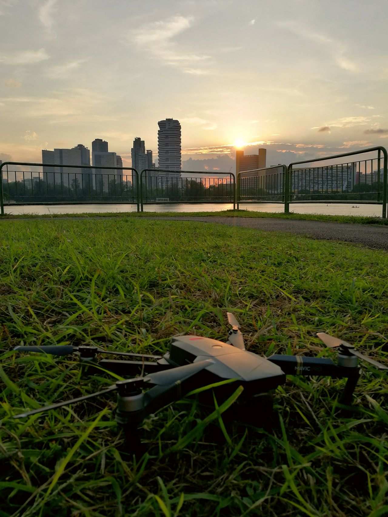 Grass Sunset Outdoors Sky No People City Building Exterior Architecture Day Cityscape Drone  Djimavicpro Waterfront Water Urban Skyline Skyline Reflection