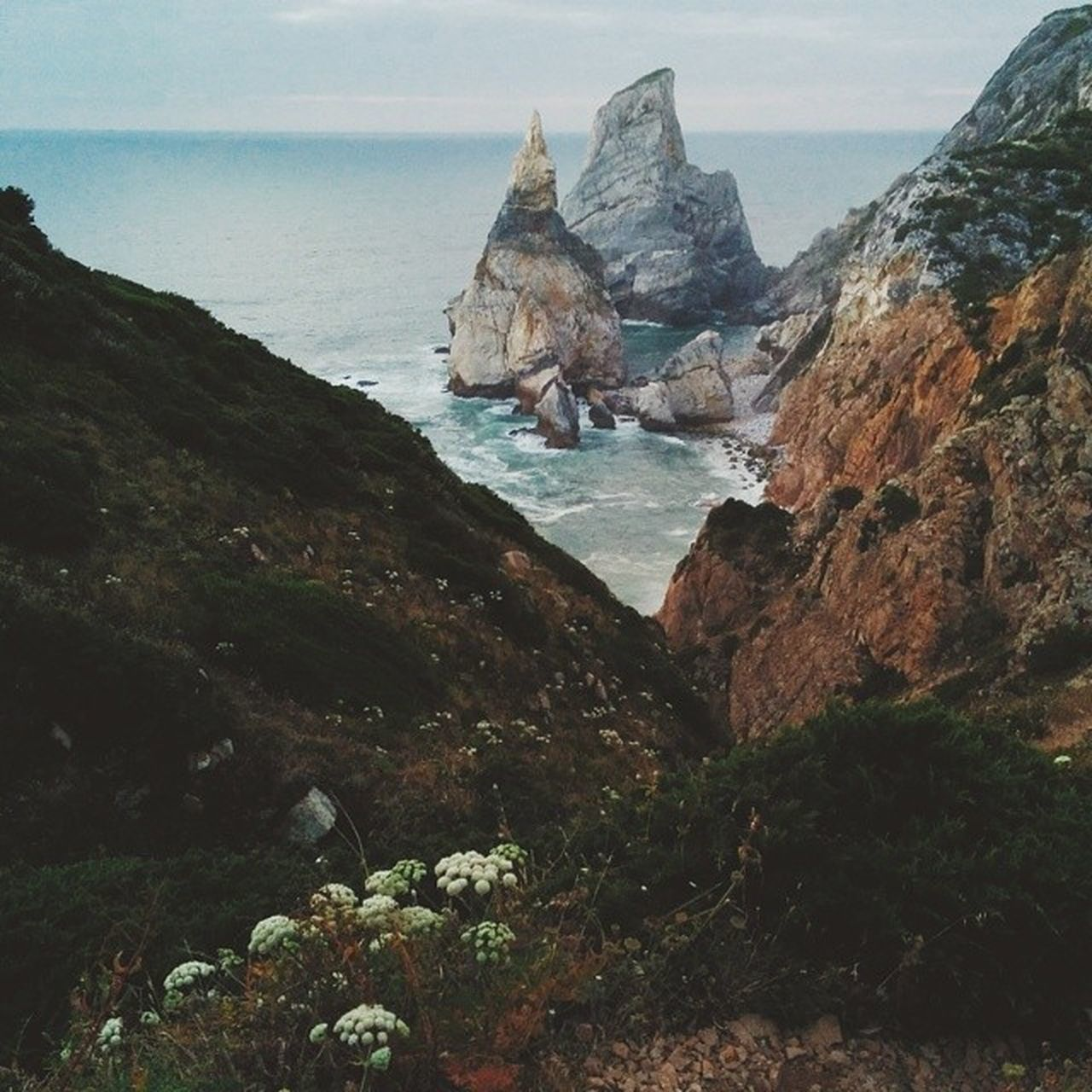 mountain, rock - object, rock formation, nature, scenics, beauty in nature, water, tranquility, no people, sea, tranquil scene, day, sky, cliff, outdoors