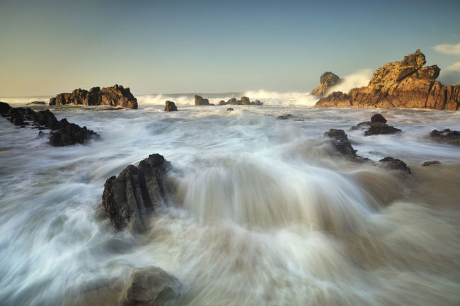 Waves Crashing On Rocky Beach Beauty In Nature Coastline Day Geology Horizon Over Water Idyllic Motion Nature No People Non Urban Scene Non-urban Scene Outdoors Power In Nature Remote Rock Rock - Object Rock Formation Scenics Sea Sky Tranquil Scene Tranquility Travel Destinations Water Wave