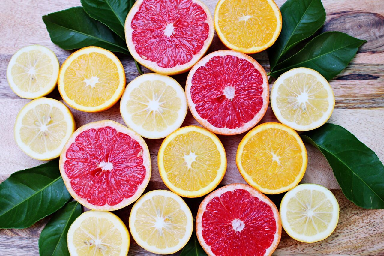 Citrus Fruit Lemon Grapefruit SLICE Healthy Eating Food And Drink Fruit Cross Section Lime No People Leaf Studio Shot Food Variation Freshness Multi Colored Indoors  High Angle View Choice Close-up