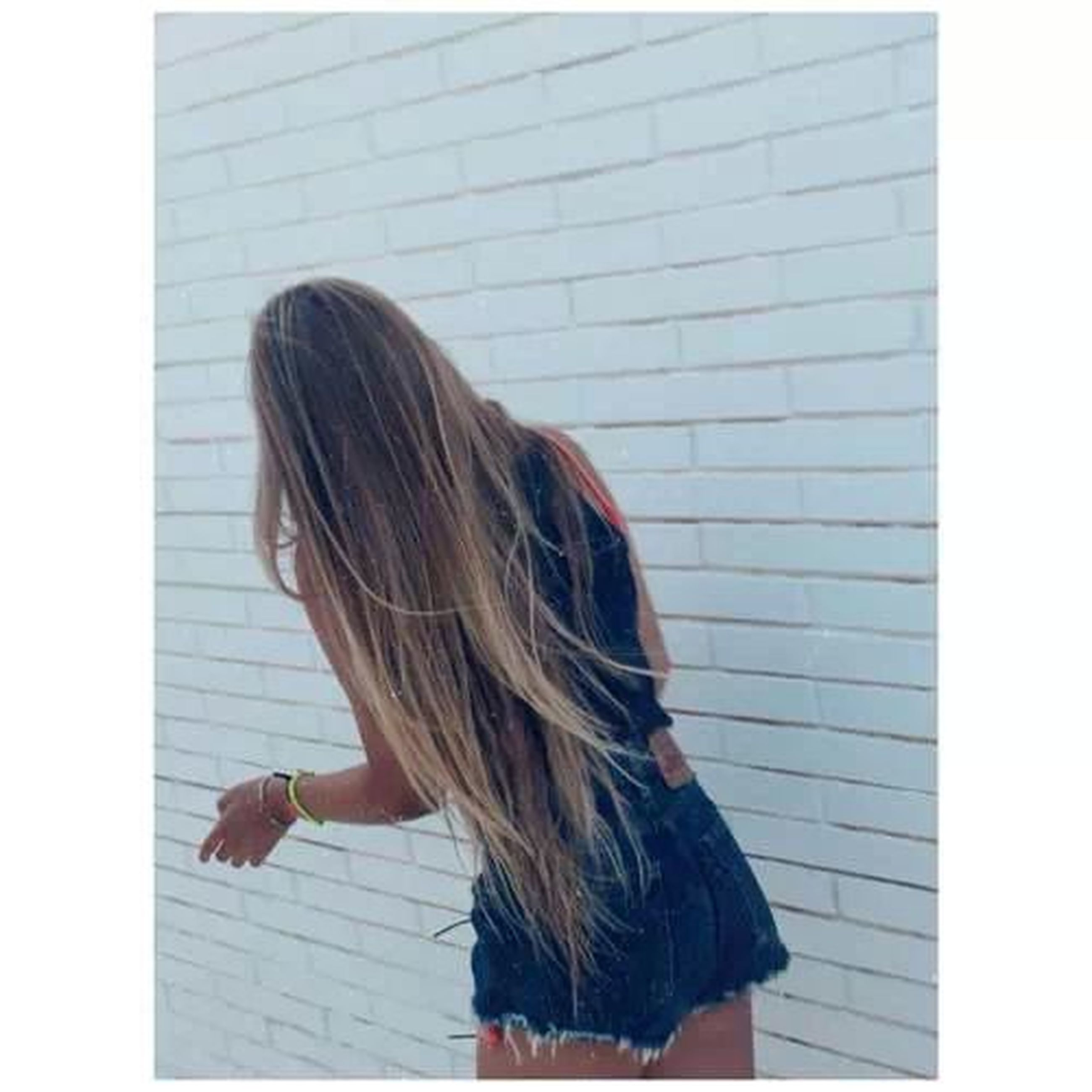 transfer print, long hair, lifestyles, auto post production filter, young women, person, leisure activity, young adult, rear view, indoors, waist up, casual clothing, brown hair, standing, side view, blond hair, wall - building feature