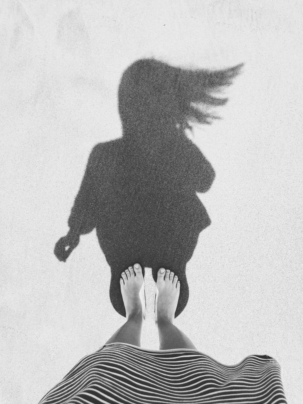 Hair in the wind Barefoot Black And White Photography Blackandwhite Day Female Foot From Above  Hair In The Wind Human Body Part IPhoneography Iphonephotography Minimal Outdoors Portrait Sand Shadow Silhouette Summer Toes Vacation Wind Woman Portrait
