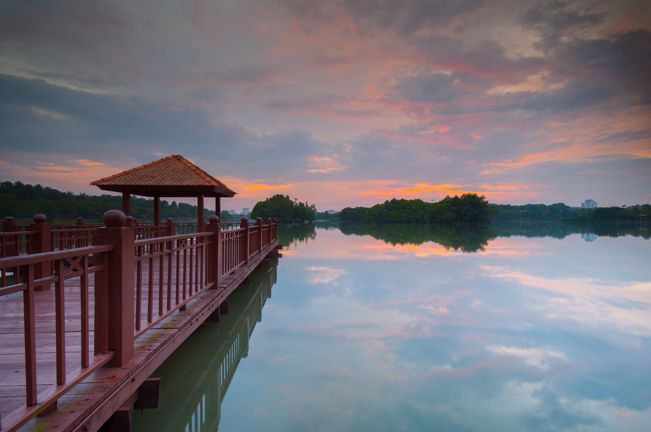 Jetty at wetland Putrajaya lake during sunset Beauty In Nature Cloud - Sky Day Lake Lakeside Landscape Mountain Multi Colored Nature No People Outdoors Pier Reflection Scenics Sky Sunset Tranquility Travel Watching The Sunset Water