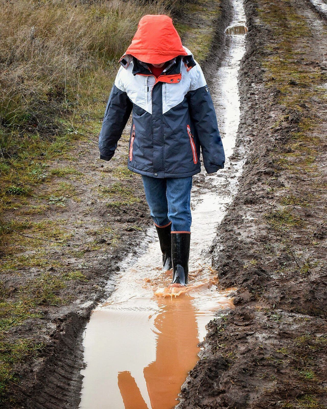 Walking Rear View Full Length Nature Rain Hiking Water Outdoors Standing Real People One Person Adventure Day Scenics Landscape People Tree Beauty In Nature Always Be Cozy Childhood Rubber Boots Puddles Puddleography Walking In A Puddle Playing