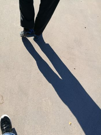 Low Section Shadow Person Sunlight Street Walking Lifestyles Leisure Activity Shoe Human Foot Outdoors Day Personal Perspective