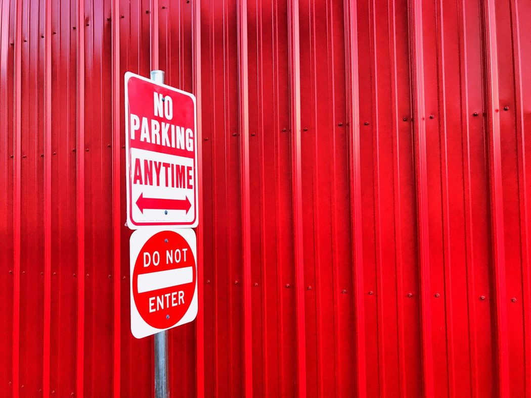 Red Communication Text Fire Alarm Day Outdoors Guidance No People Urgency Corrugated Iron Close-up No Parking Sign Red Red Color Alley Warning Sign Warning Dominant Color Do Not Enter