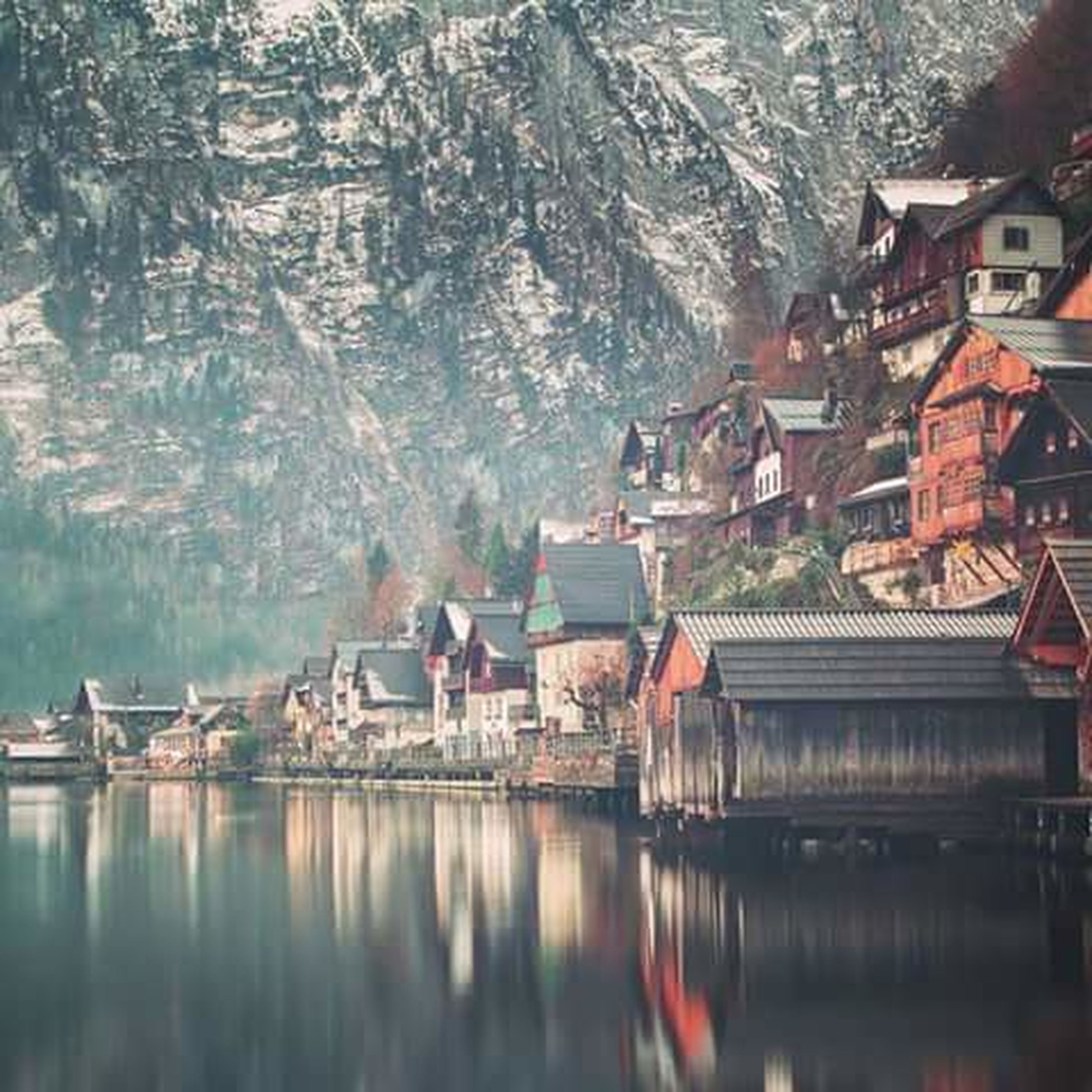 water, building exterior, architecture, built structure, waterfront, reflection, house, residential structure, river, lake, residential building, town, tree, canal, mountain, nautical vessel, boat, nature, transportation, day