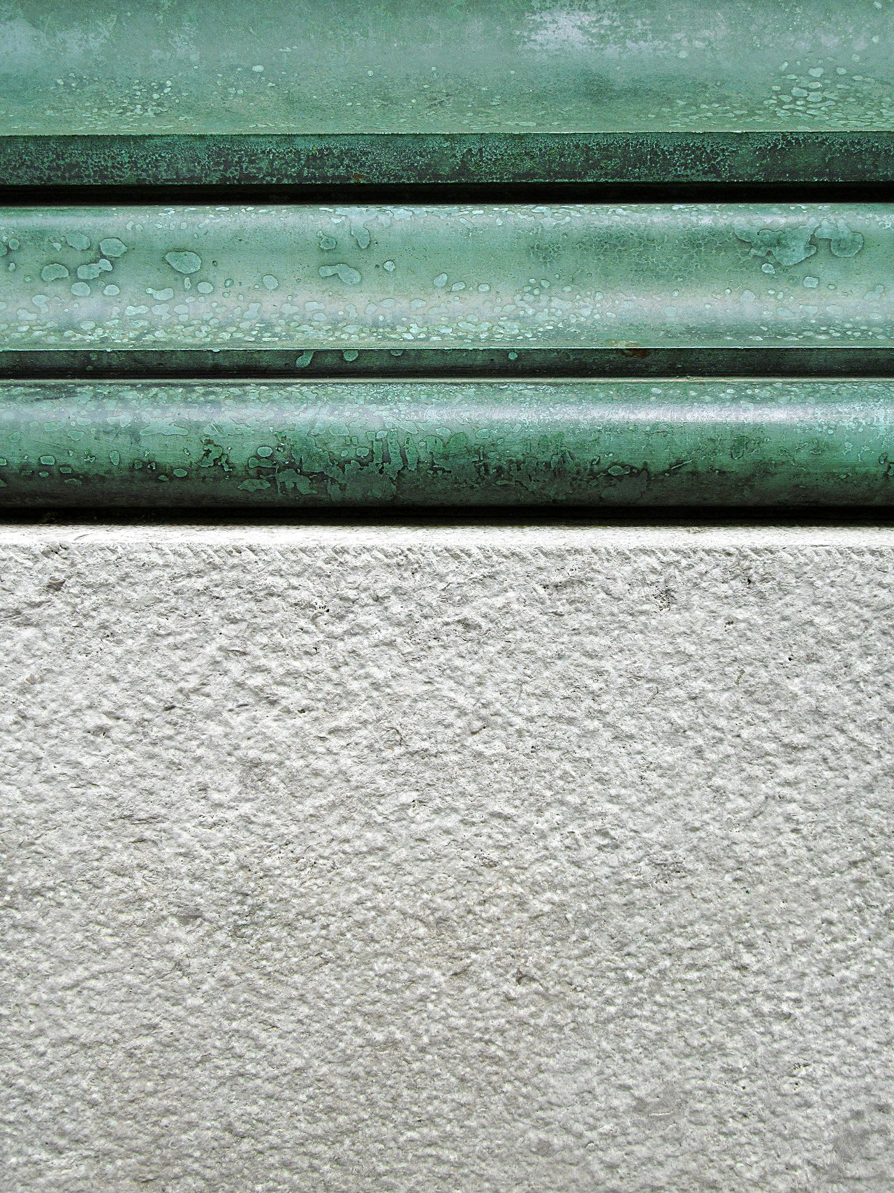 Close-up detail shot of grey stone base and green metal moulding Architectural Detail ArchiTexture Architextures Backgrounds Base Basement Close-up Day Full Frame Green Grey Moulding No People Outdoors Pattern Stone Sunlight Textured  Textures And Surfaces Torus