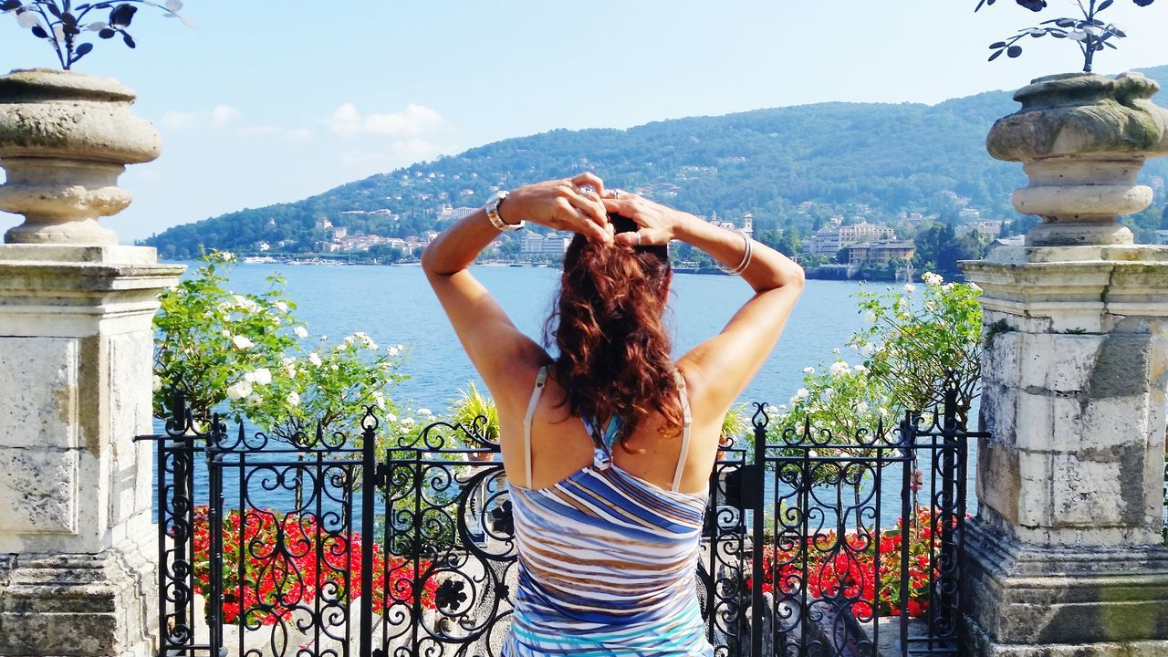 Travel One Woman Only One Person Sunlight Vacations Standing Sky Travel Destinations Beauty Women Outdoors Isola Bella Italianlandscape Amazing Day Architecture Gate Island Lake Lagomaggiore Blue Sky Flowers,Plants & Garden Human Body Part