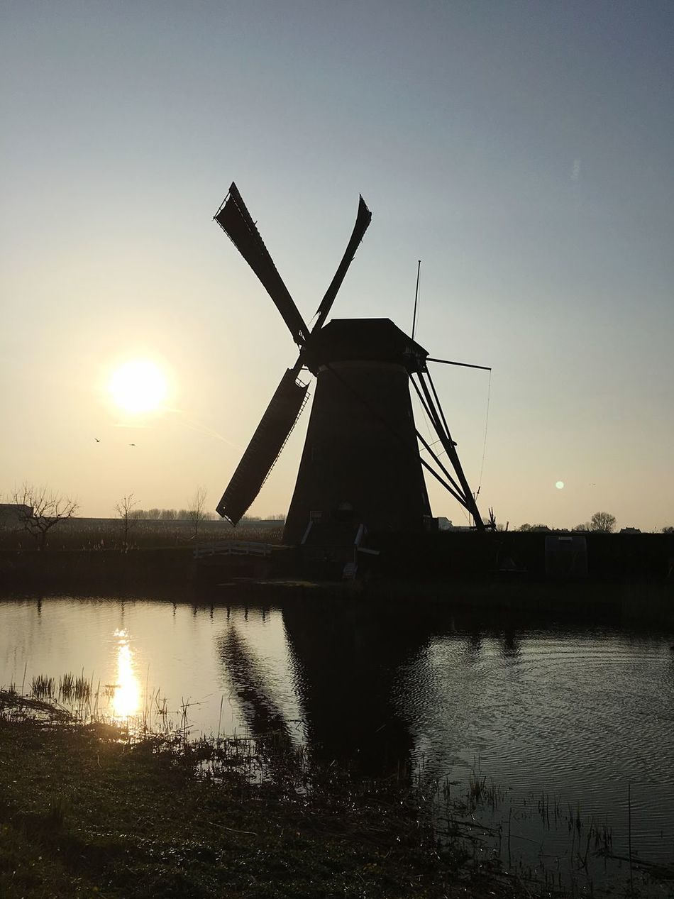 Windmill Alternative Energy Water Wind Power Wind Turbine Environmental Conservation Renewable Energy Traditional Windmill Fuel And Power Generation Built Structure Reflection Nature Architecture Rural Scene Sunset Building Exterior No People Watermill Sky Lake