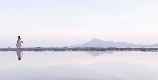 DONGSHAN ISLAND- 旅志 Reflection Water Walking Full Length Tranquility Standing Scenics Tranquil Scene Mountain Calm Standing Water Vacations Waterfront Relaxation Beauty In Nature Nature Remote Mountain Range Day Outdoors