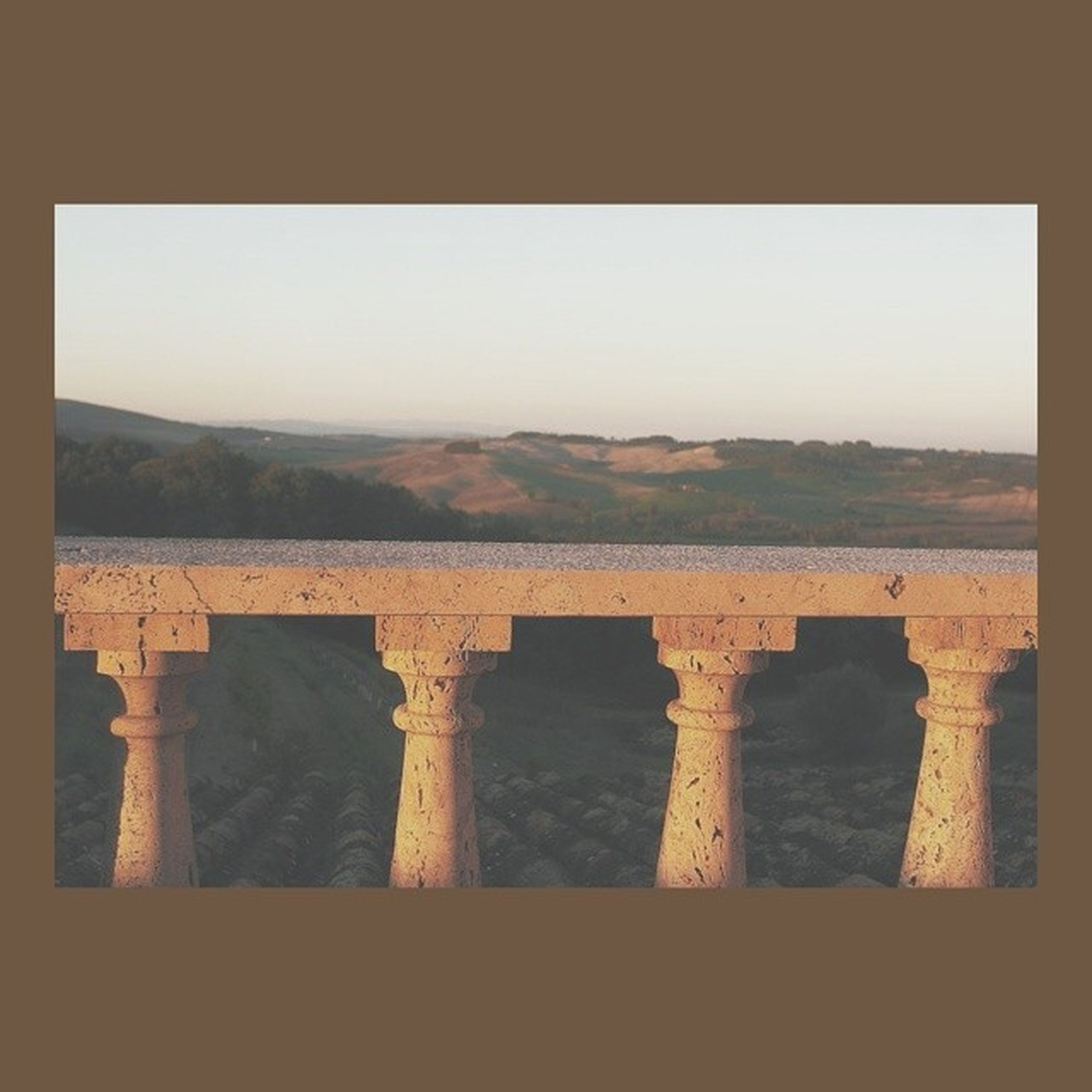 built structure, transfer print, architecture, clear sky, copy space, auto post production filter, sky, landscape, tranquility, outdoors, day, connection, nature, no people, travel destinations, tranquil scene, history, bridge - man made structure, building exterior, scenics