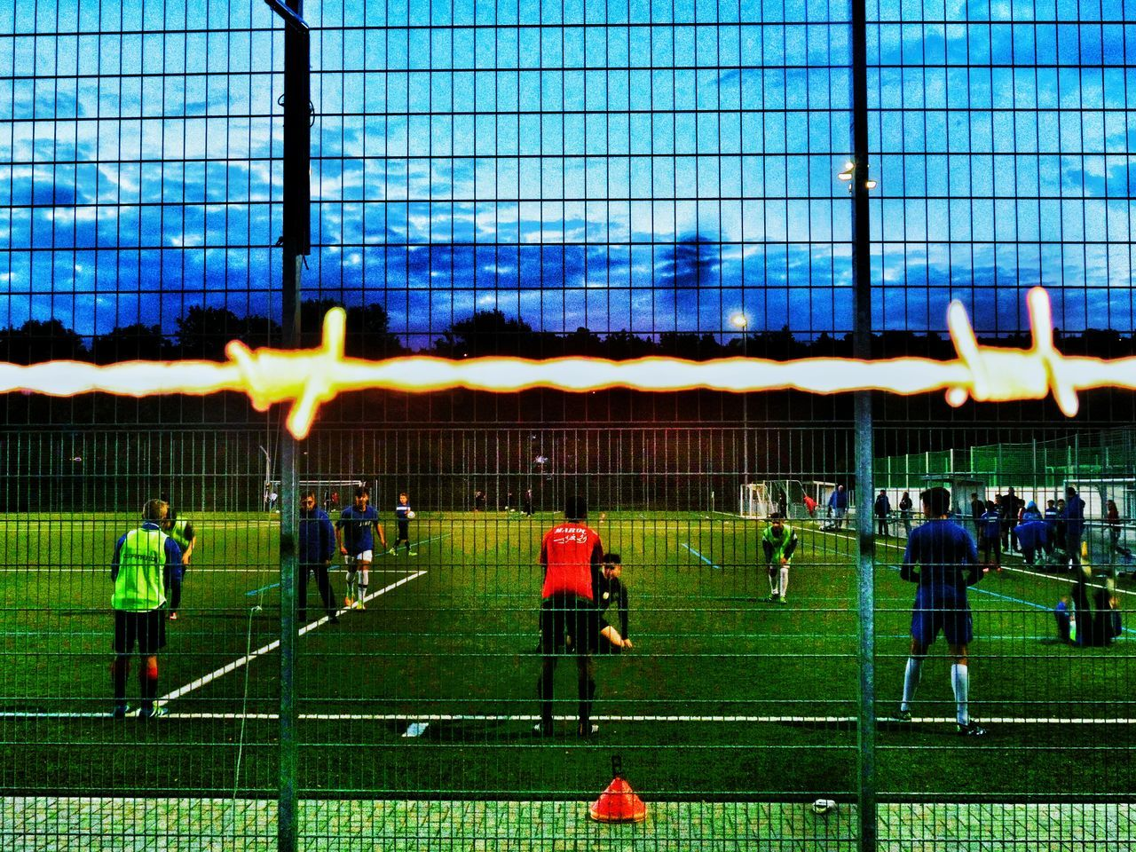 Security Behind Barbed Wire Sports Bring People Together Young People Different Nationalities In One Team Soccer Training Fussball Evening Sky Real People Large Group Of People SportSoccer Player Sports Regional Youth Soccer Team Frankfurt Am Main Germany🇩🇪 Finding New Frontiers