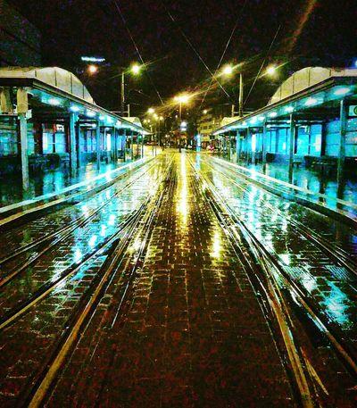Waiting for the tramway Tramway Station Tramway Rainy Night Night Photography Tramway Rail Reflected Glory Night Lights Brunswick Braunschweig Cities At Night