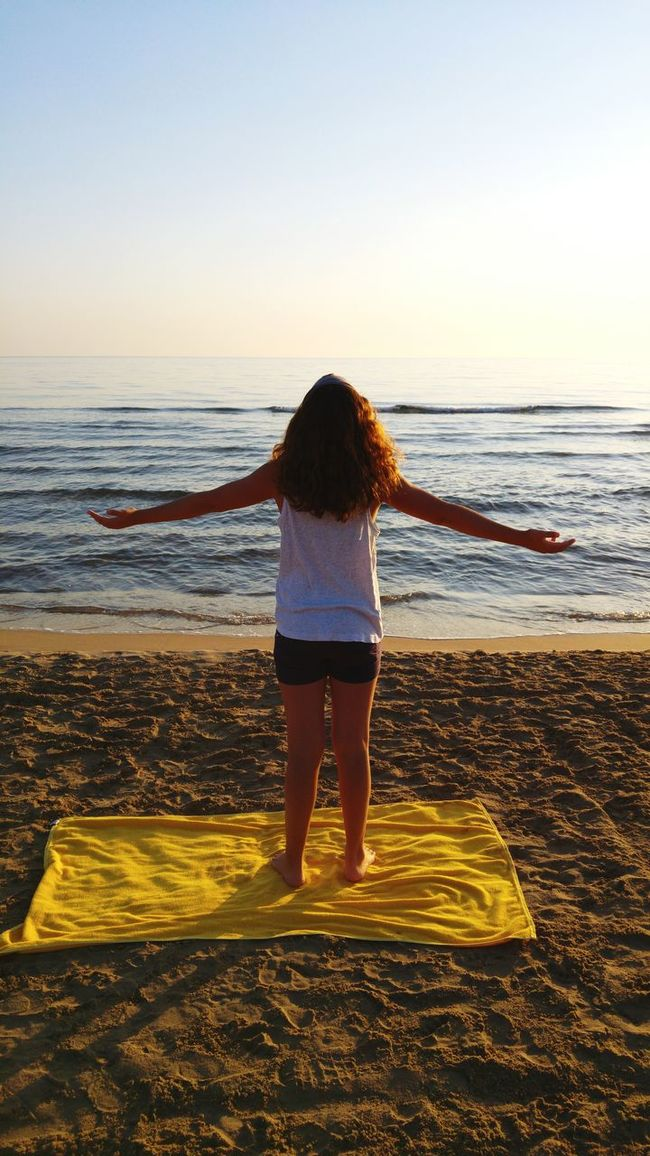 Yoga at sunrise Girl Fitness Yogagirl Yoga Practice Sunrise Yogainspiration Yogaeverywhere Rear View Sea Water Horizon Over Water Standing Person Leisure Activity Lifestyles Beach Clear Sky Beauty In Nature Full Length Tranquil Scene Scenics Tranquility Vacations Nature Relaxation