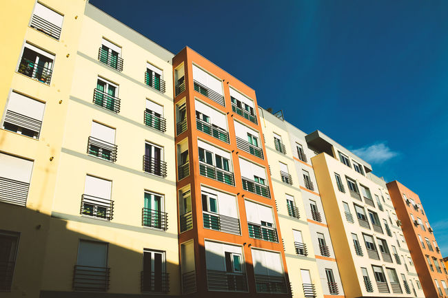 Apartment Architecture Balcony Blue Building Building Exterior Built Structure City Clear Sky Day Façade House Low Angle View No People Outdoors Residential Building Residential Structure Sky Sunlight Window