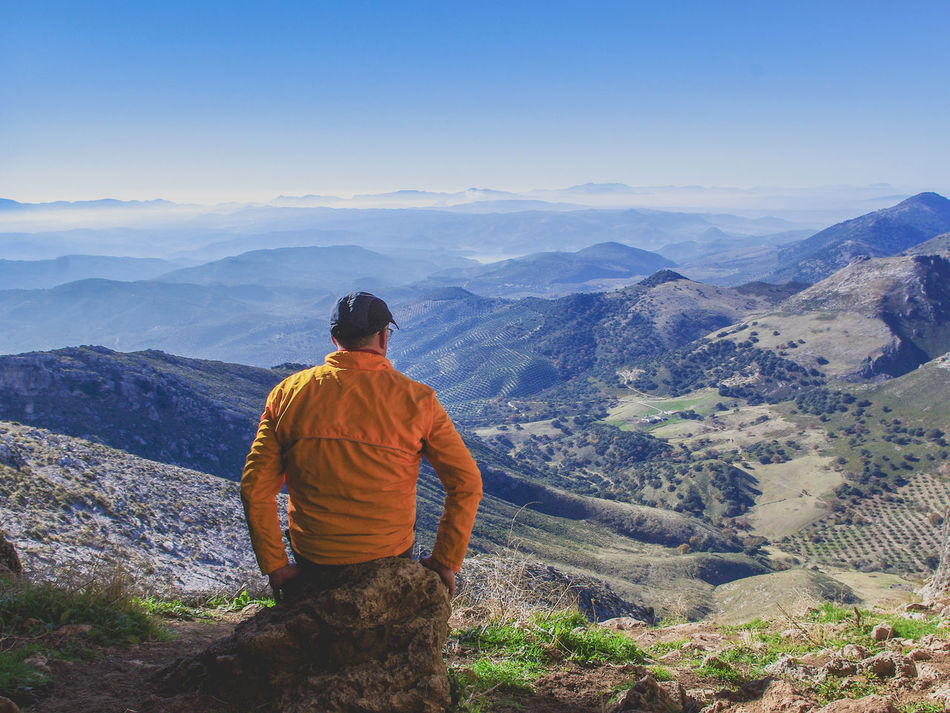 Rear view of man looking at mountains against clear sky Achievement Adult Adults Only Beauty In Nature Blue Sky Break Day Hiking Mountain Mountain Peak Mountain Range Nature One Man Only One Person Only Men Outdoors People Rear View Sky Sports Success Copy Space Space For Copy Space For Text The Great Outdoors - 2017 EyeEm Awards