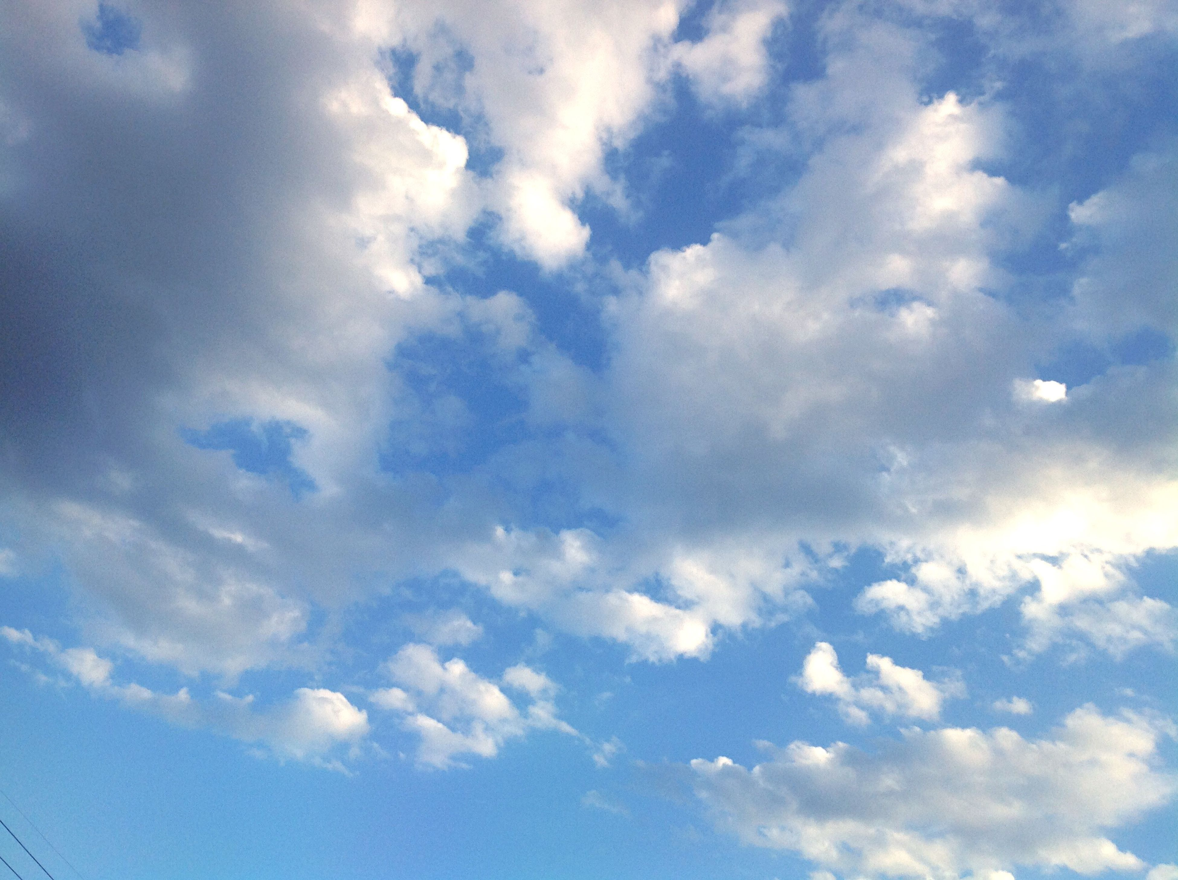 sky, low angle view, cloud - sky, blue, sky only, beauty in nature, tranquility, scenics, cloudy, nature, cloudscape, cloud, backgrounds, tranquil scene, full frame, idyllic, white color, outdoors, day, no people