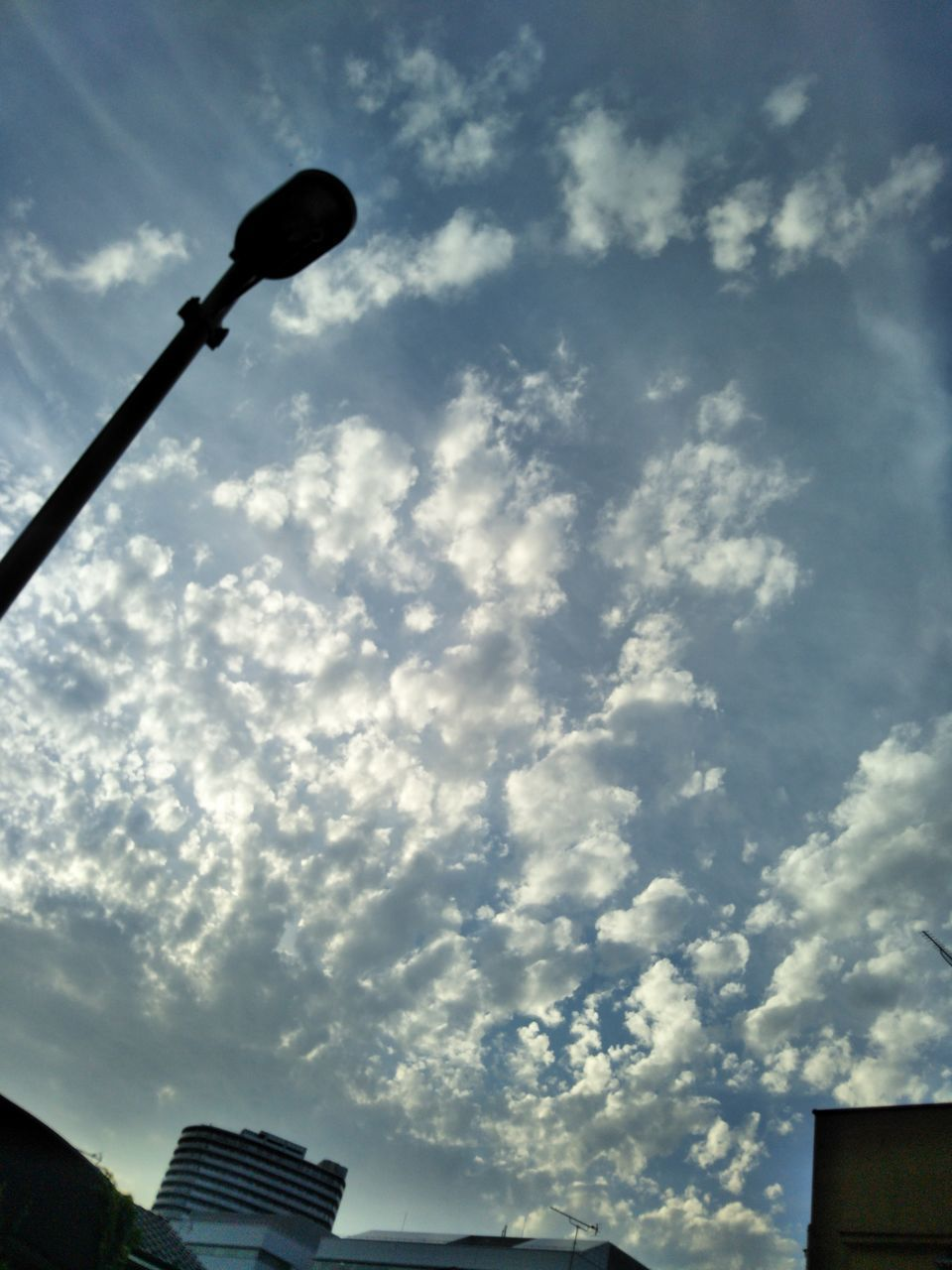 low angle view, sky, street light, cloud - sky, no people, outdoors, architecture, day