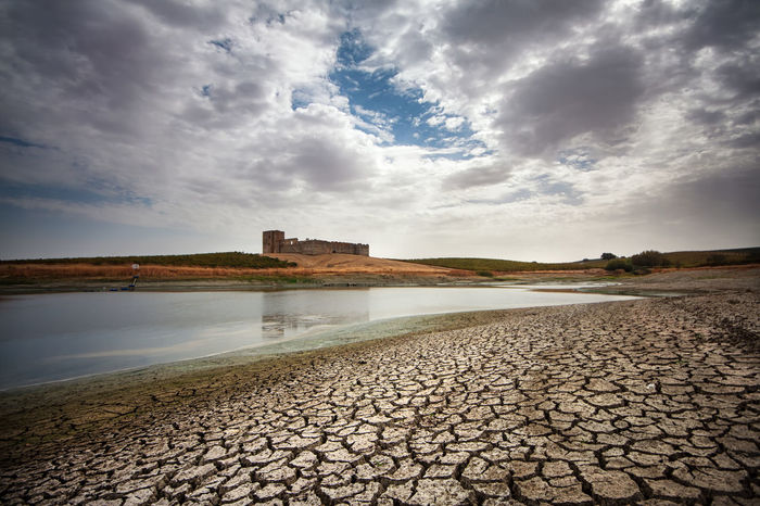 Alentejo,Portugal Alentejo Alqueva Ancient Architecture Beauty In Nature Building Exterior Built Structure Castel Cloud - Sky Day History Lake Nature No People Old Ruin Outdoors Reflection Rock - Object Scenics Sky Stone Material Water