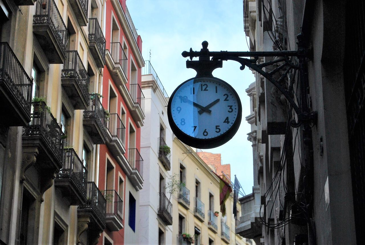 Time Clock Building Exterior Architecture Built Structure Roman Numeral Clock Face Minute Hand Outdoors No People Day Instrument Of Time City Hour Hand Sky Astronomical Clock Streetphotography Street Photography Cityscapes Barcelona
