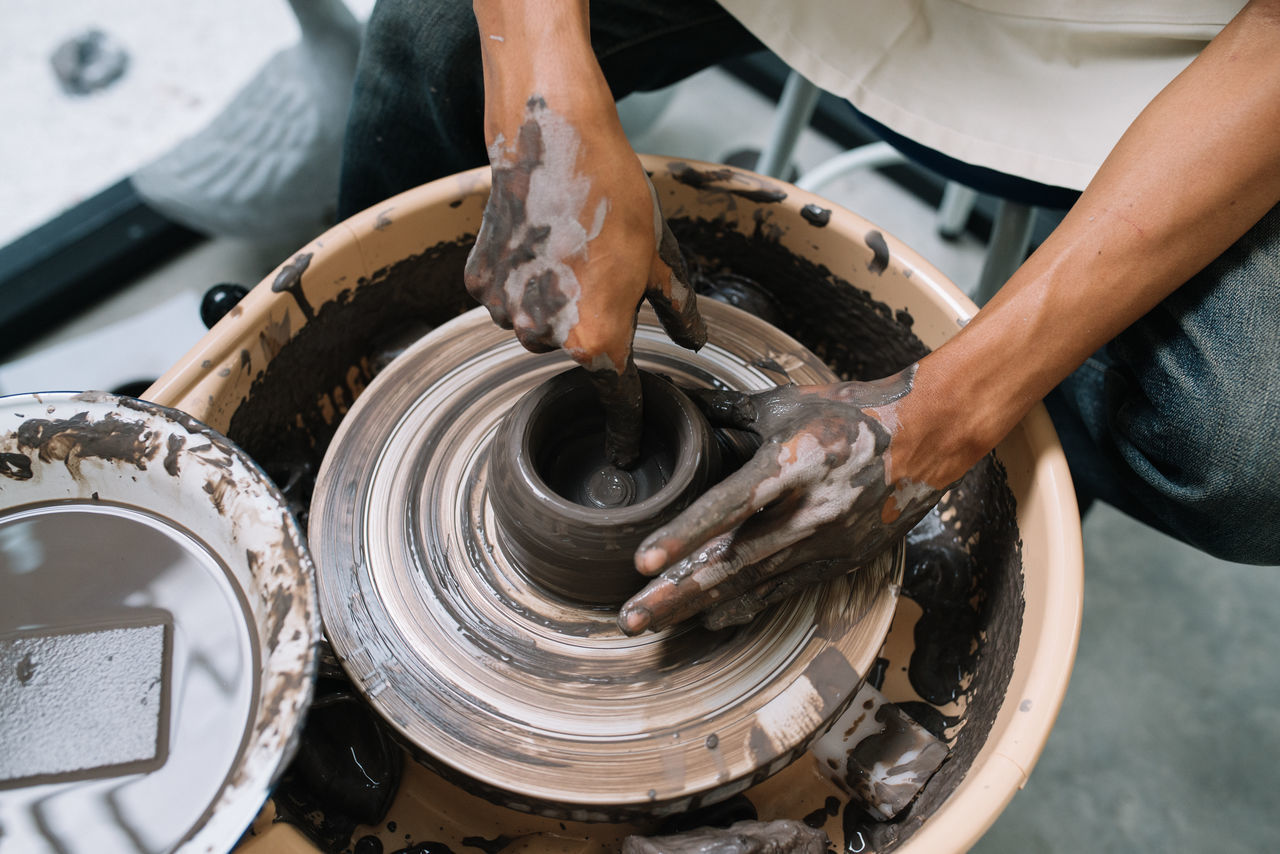 Ceramic artist at work with a potter's wheel Ceramic Art Crafting Creating Handcraft Hands Hands At Work Human Hand Potter's Wheel Pottery Process Sculpting Sculpting Wheel Wheel Throwing Working Process