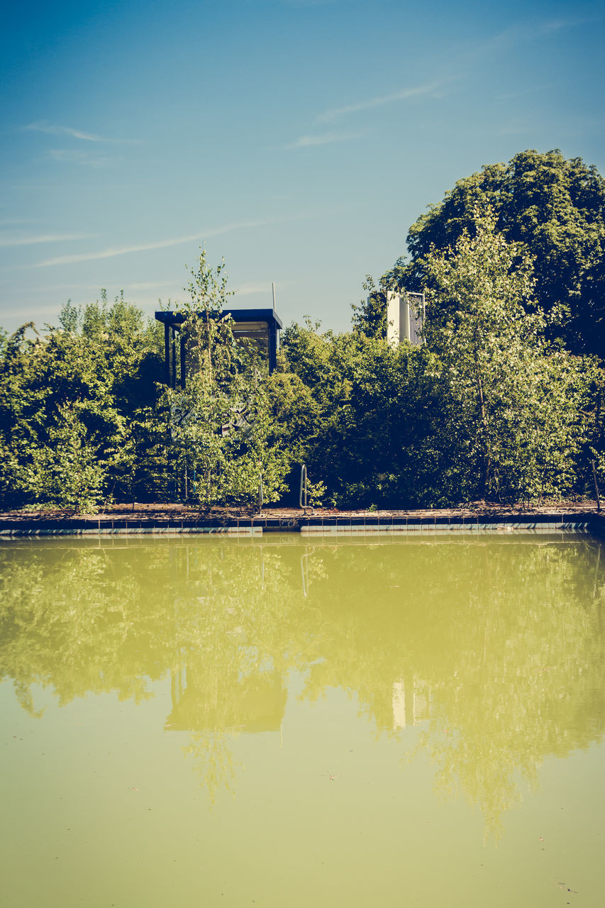 tree, reflection, architecture, built structure, no people, water, sky, day, outdoors, building exterior, industry