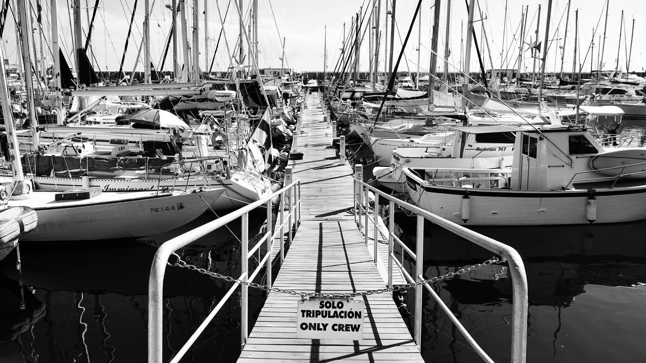 Marina Nautical Vessel Railing Moored Transportation Water Mode Of Transport Sailboat Outdoors Harbor Sky Day Tranquility Sea No People The Way Forward Tranquil Scene Wood Paneling