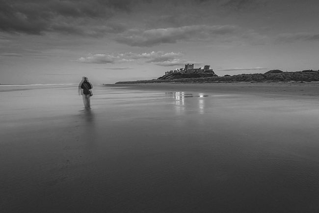 Sandy Dusk People And Places Tranquil Scene Beach Scenics Tranquility Reflection Solitude Beach Photography Beach Reflections Remote EyeEm Masterclass Idyllic Landscape Bamburgh Northumberland Lone Walker BW Collection Beach Walk Long Exposure Shot Beach And Sky Coastline Beauty In Nature Atmospheric Mood