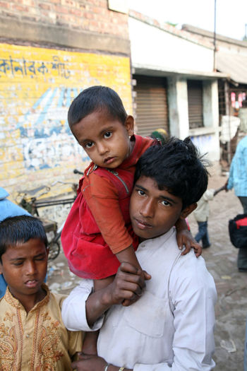 Alindra Jana holding his little sister Sabita at remote village Kumrokhali, West Bengal, India on January 12, 2009. Adolescent ASIA Brother Child Front View India Innocence Kumrokhali Lifestyles Looking At Camera Person Portrait Sister Togetherness West Bengal