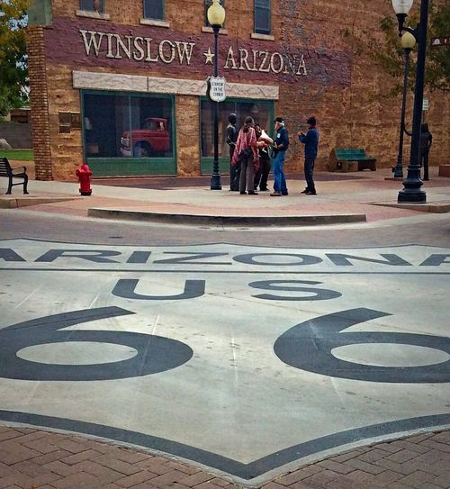 """Standin' on a corner in Winslow Arizona.."" 'Take it easy' by The Eagles Unique People And Places Winslow Az Iconic Song Music The Eagles Take It Easy History Rock Music Classic Rock Classic Arizona Tourism Tourist Attraction  Home Home State Small Town Eye Em Around The World Eye Em Travel Destinations Atmosphere Small Town USA Road Sign Atmospheric Mood"