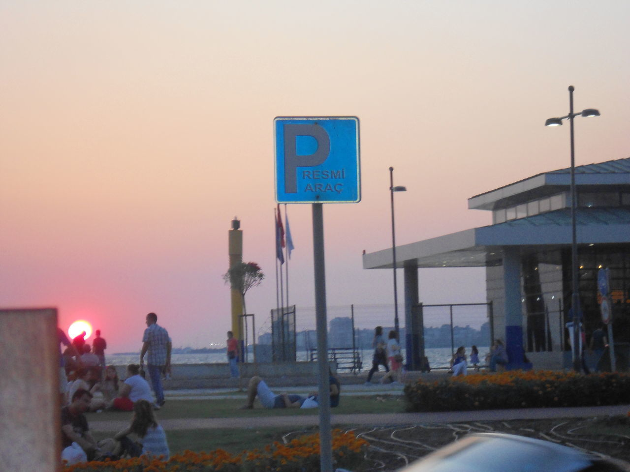 Turkey/ızmir-alsancak Sunset With Person Shadow Parking Lot There is a man at the front of sunset Merry People Who Try To Fish PARK(for Official Cars)