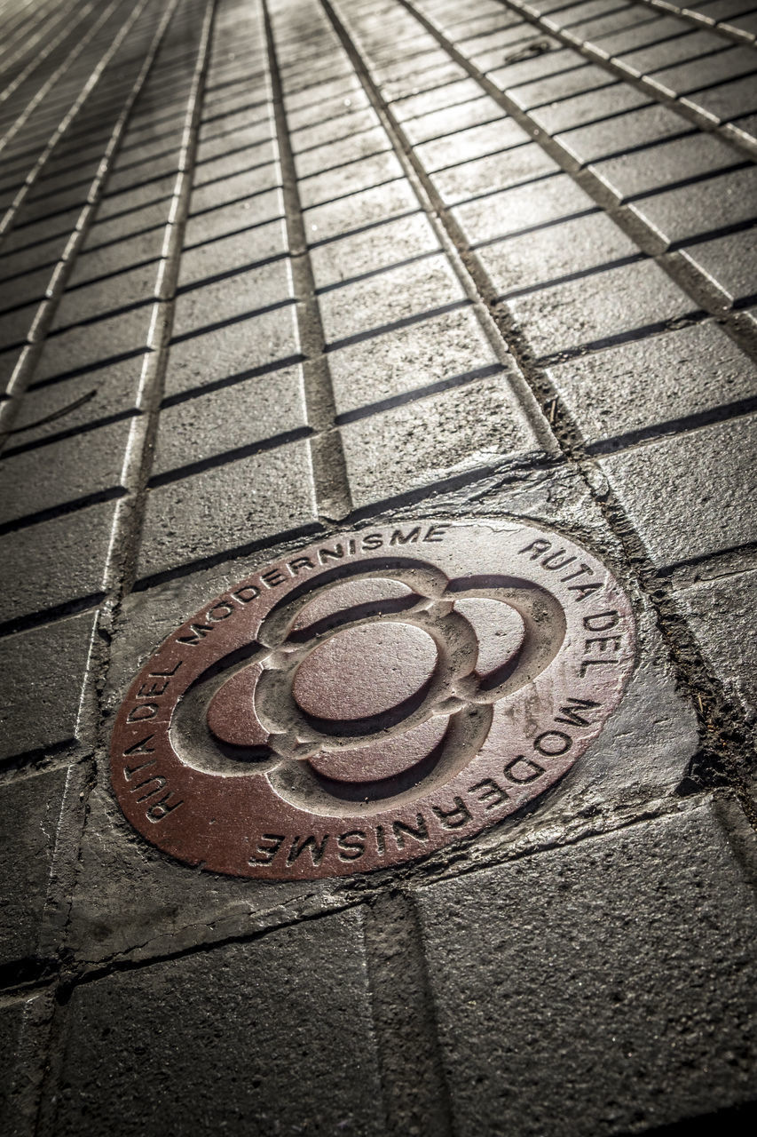 pattern, no people, text, communication, manhole, close-up, outdoors, day