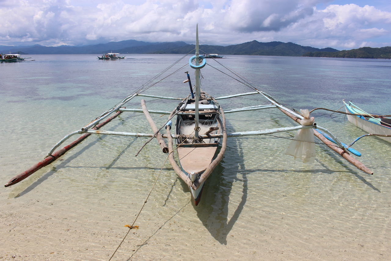 cloud - sky, sky, sea, water, mountain, scenics, mode of transport, outdoors, day, nature, transportation, tranquility, nautical vessel, no people, beauty in nature, hanging, horizon over water, beach, outrigger