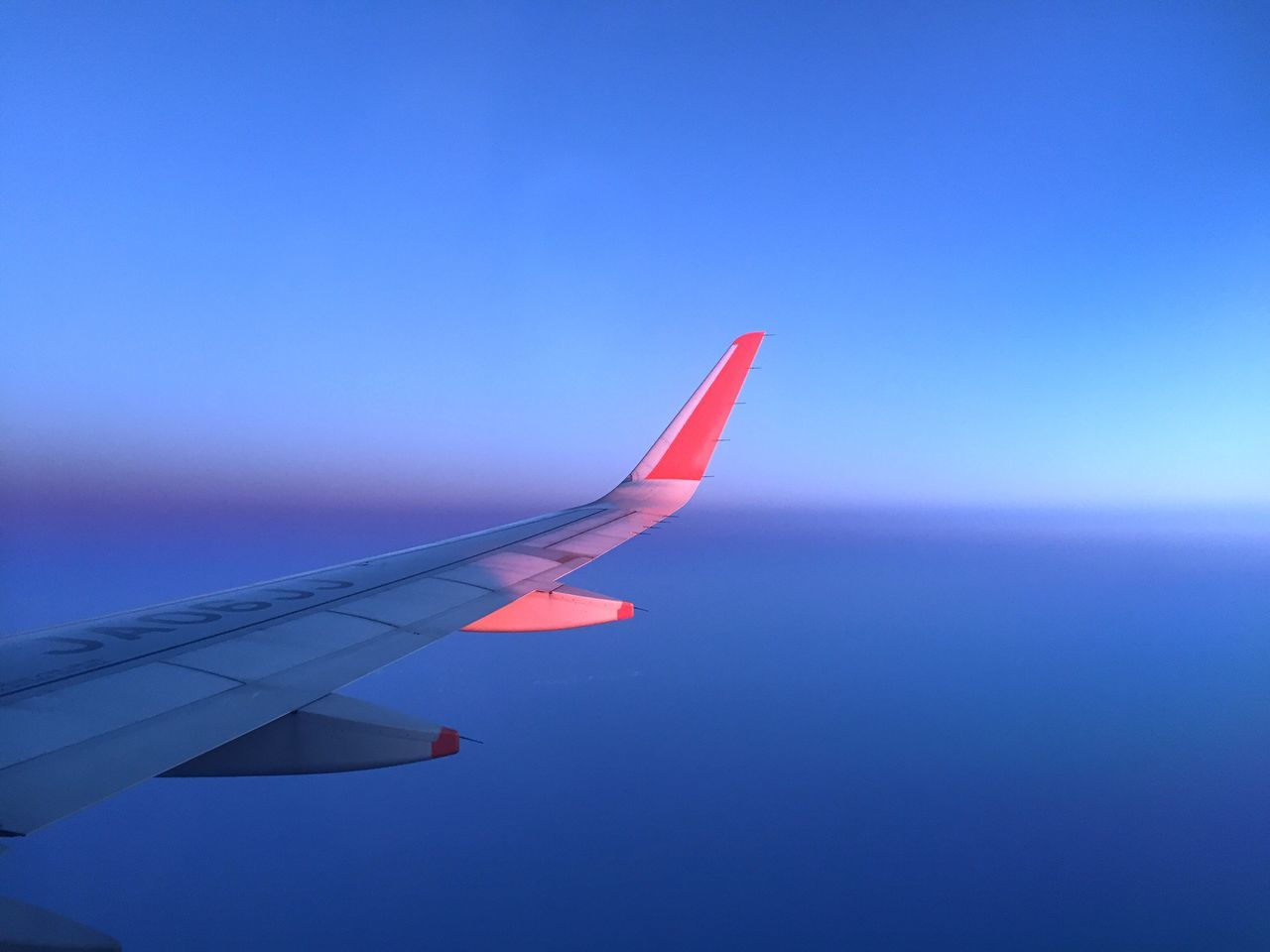 Flying Hues. Airplane Journey Blue Transportation Airplane Wing Flying Air Vehicle Travel Aircraft Wing Sky Nature Mid-air Aerial View Day Outdoors Beauty In Nature Clear Sky Close-up