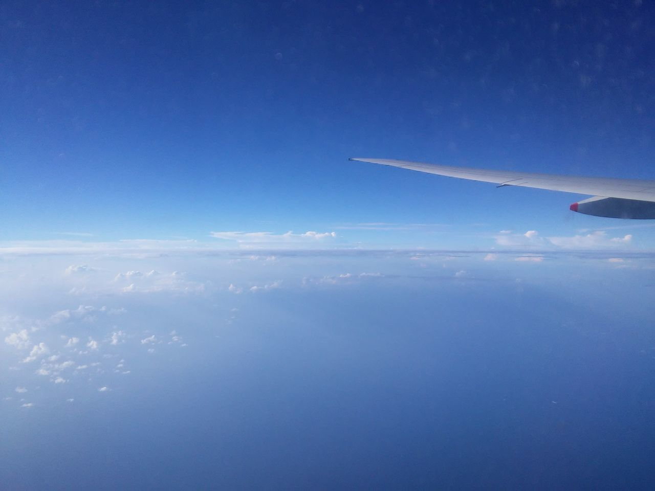 airplane, transportation, sky, blue, journey, aerial view, airplane wing, flying, nature, air vehicle, mid-air, travel, mode of transport, cloud - sky, scenics, beauty in nature, no people, day, outdoors