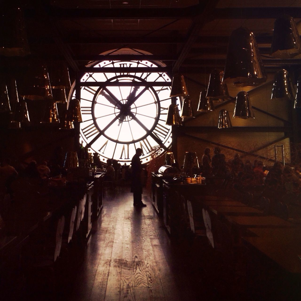clock, indoors, time, clock face, real people, roman numeral, standing, day, minute hand, one person, people