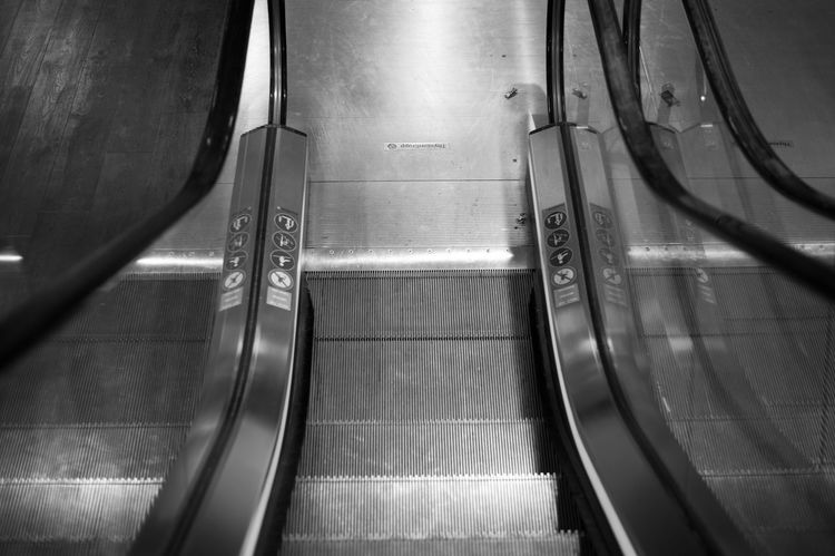 Escalating Destination Unknown Black And White Photography Black And White Streetphoto_bw Street Photography Urban Photography Urbanphotography Urban Exploration Traveling Urban Geometry Escalator