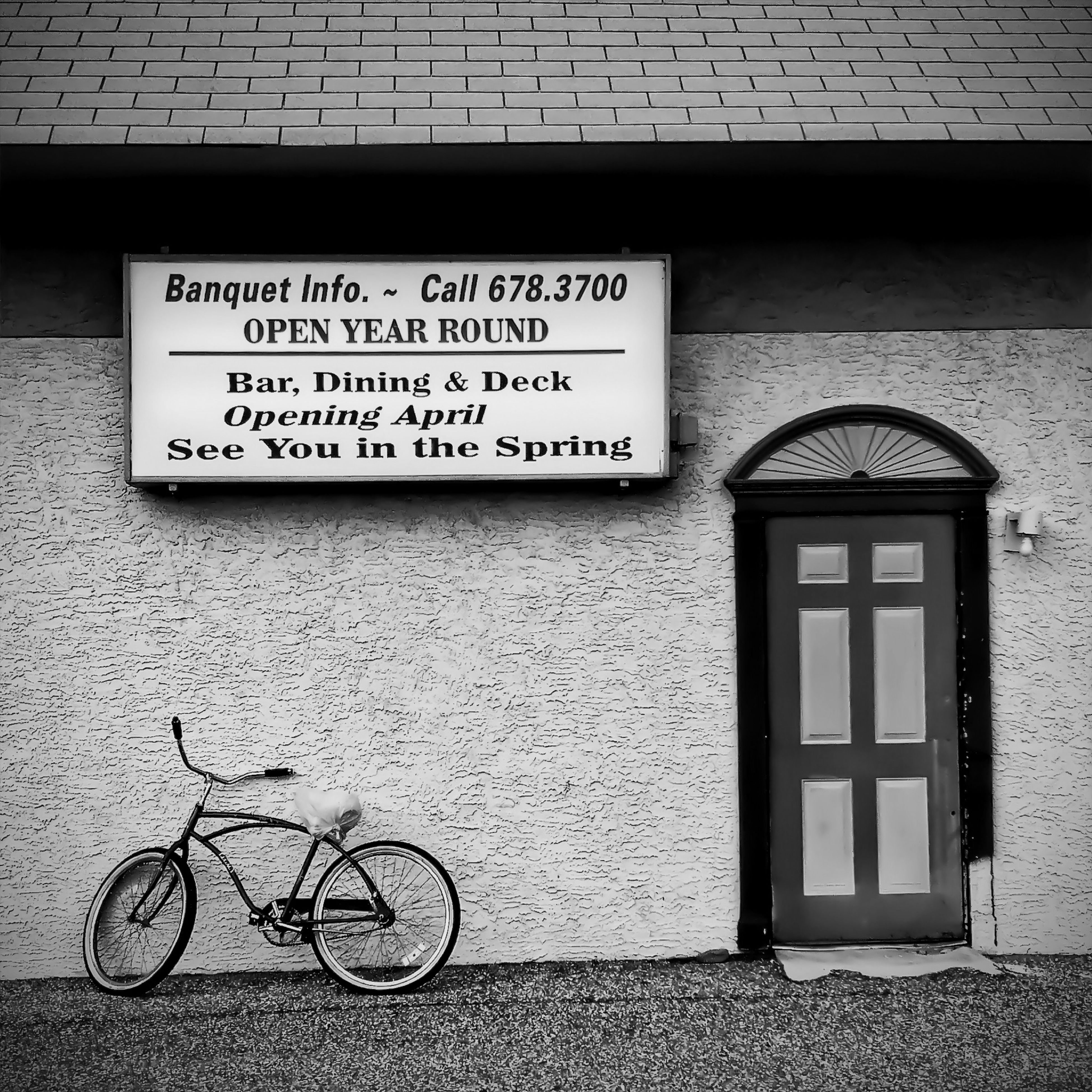 text, bicycle, western script, communication, architecture, building exterior, built structure, transportation, information sign, capital letter, wall - building feature, sign, mode of transport, street, information, non-western script, land vehicle, window, city, parking